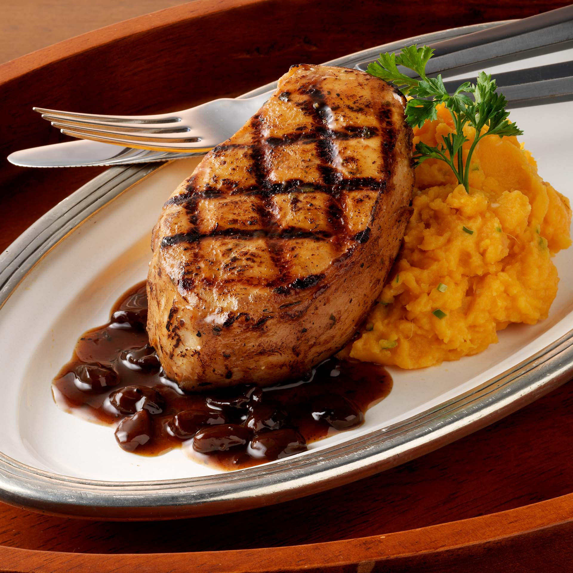 Grilled Jamaican Jerk Pork Chops with Raisin-Rum Sauce and Garlic ...